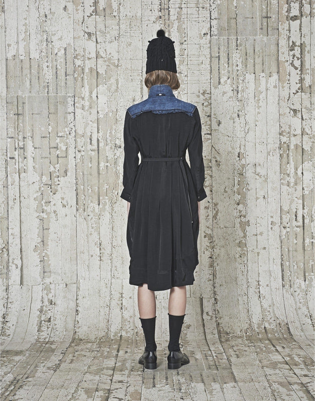 High by Claire Campbell Fervent Denim Dress in Navy with curved bib section in pre-creased denim available at Debs Boutique. Styled on model back view.
