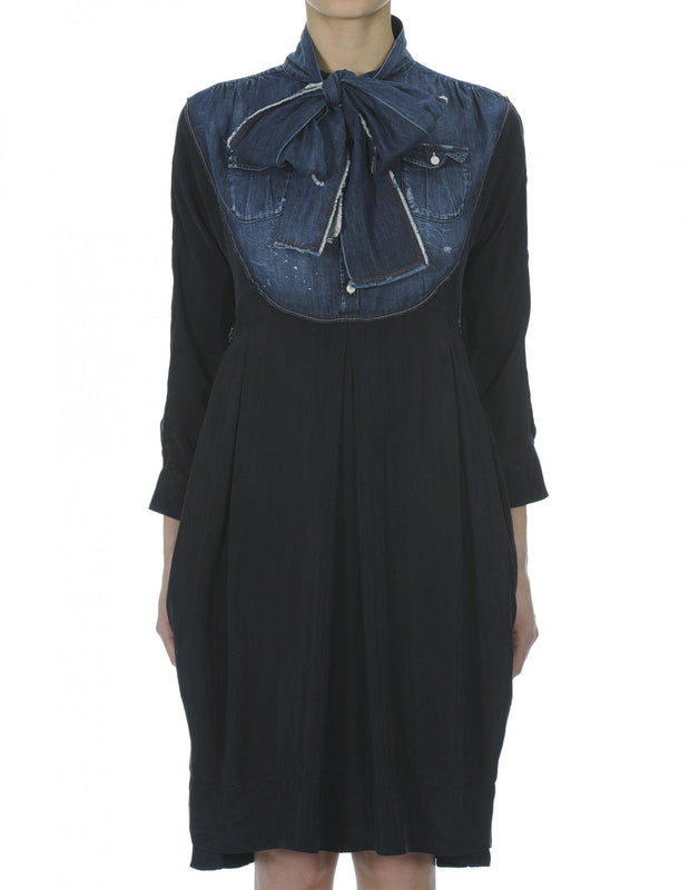 High by Claire Campbell Fervent Denim Dress in Navy with curved bib section in pre-creased denim available at Debs Boutique. Front view.