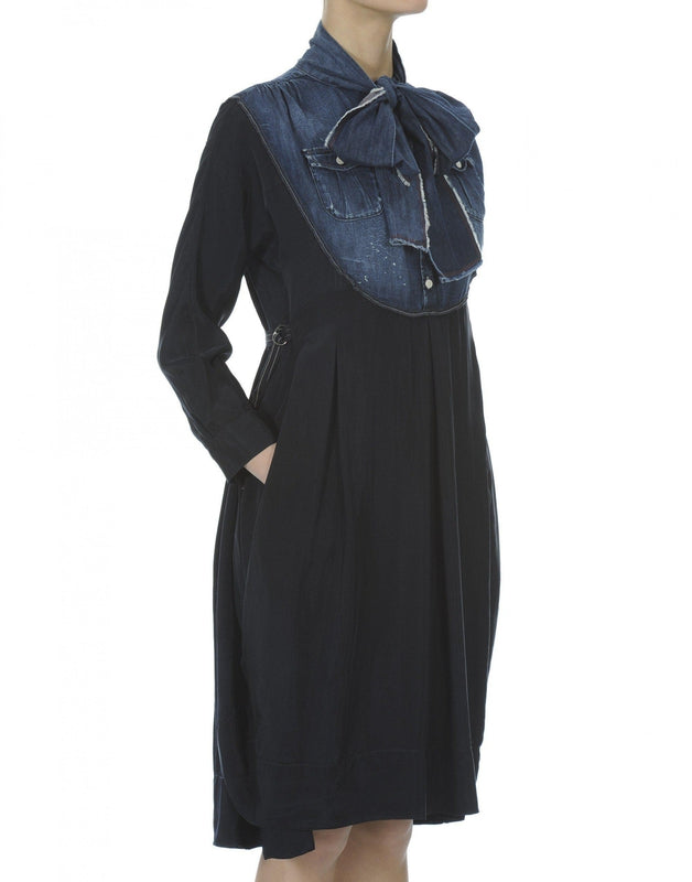 High by Claire Campbell Fervent Denim Dress in Navy with curved bib section in pre-creased denim available at Debs Boutique. Side view.