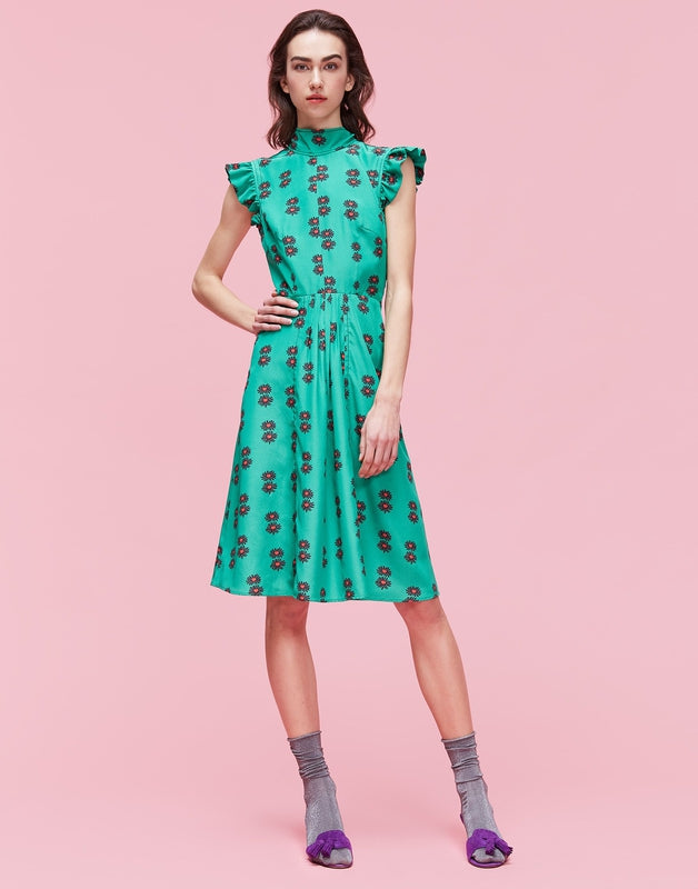 Green Bon Ton Dress from La DoubleJ on model with socks and heels against pink background at Debs Boutique.