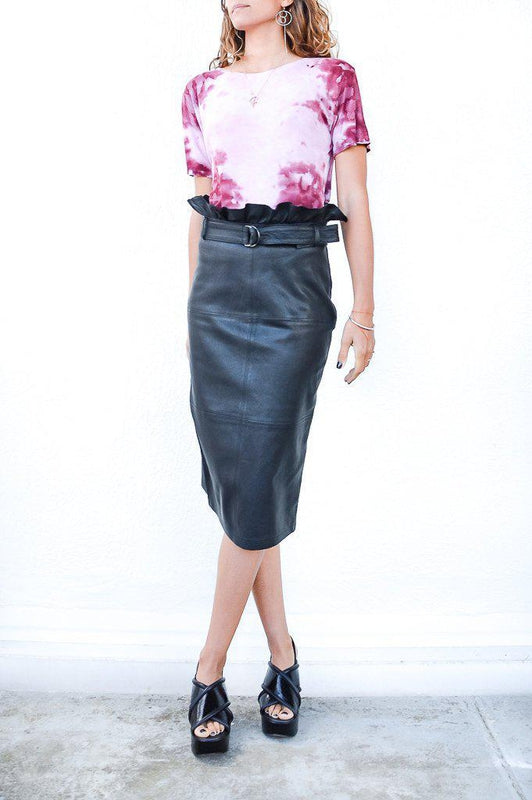J Brand Claudia Leather Midi Skirt in Black with a high waist fit as well as ruffles around the waist available at Debs Boutique. Styled on model with our Enza Costa Rib Short Sleeve Boy Tee.