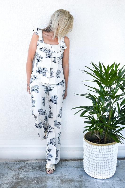 Sea NY Josephine Flare Pant in Cream Floral Coupe with high waist, flared bottom and back pockets available at Debs Boutique. Styled on model front view.