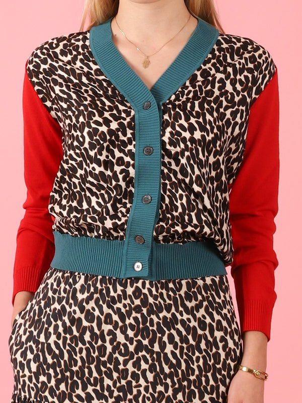 La Double J Gemini Cardigan in Leopard with red sleeves available at Debs Boutique. Styled on model front view.