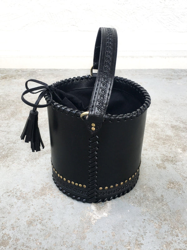Ulla Johnson Andra Crossbody leather bag in black with floral engraves, brass toned studs and tassels at Debs Boutique - front view