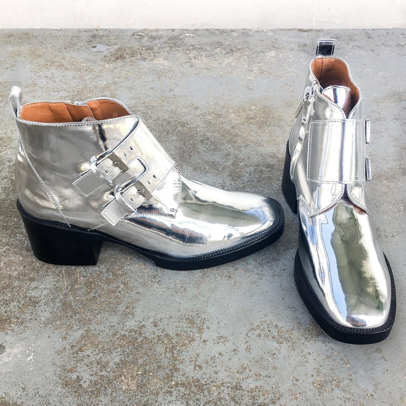 Clergerie Caius Ankle Boots in shiny silver with square toe and buckled straps at Debs Boutique. Side and front view