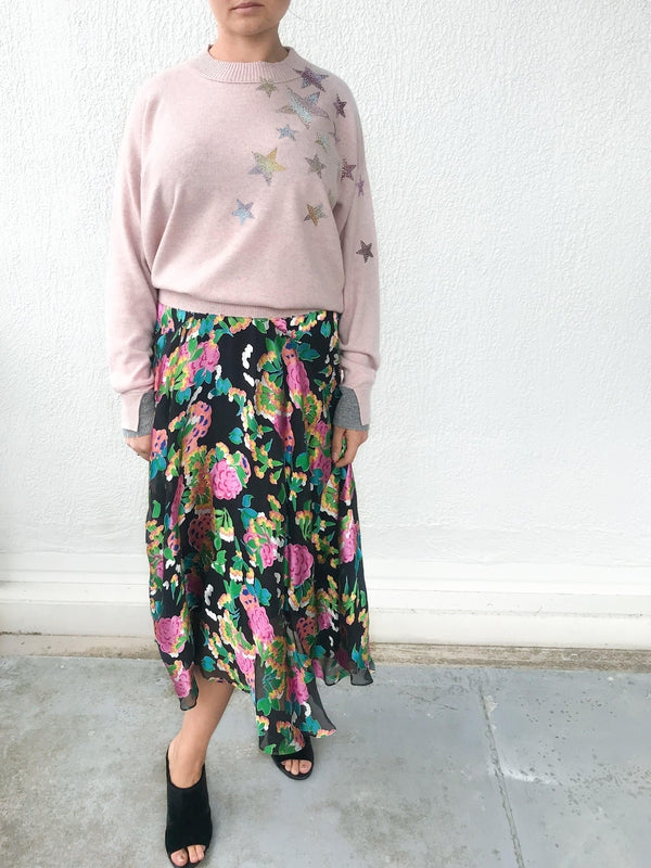 Saloni Ida Skirt in Hydrangea Floral print with soft sheer details, a high fitted waist and ankle length available at Debs Boutique. Styled on model wearing Zadig & Voltaire Gaby C Star Sweater and Clergerie Maevat Mules. Front view.