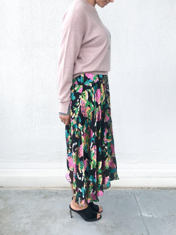 Saloni Ida Skirt in Hydrangea Floral print with soft sheer details, a high fitted waist and ankle length available at Debs Boutique. Styled on model wearing Zadig & Voltaire Gaby C Star Sweater and Clergerie Maevat Mules. Side view.
