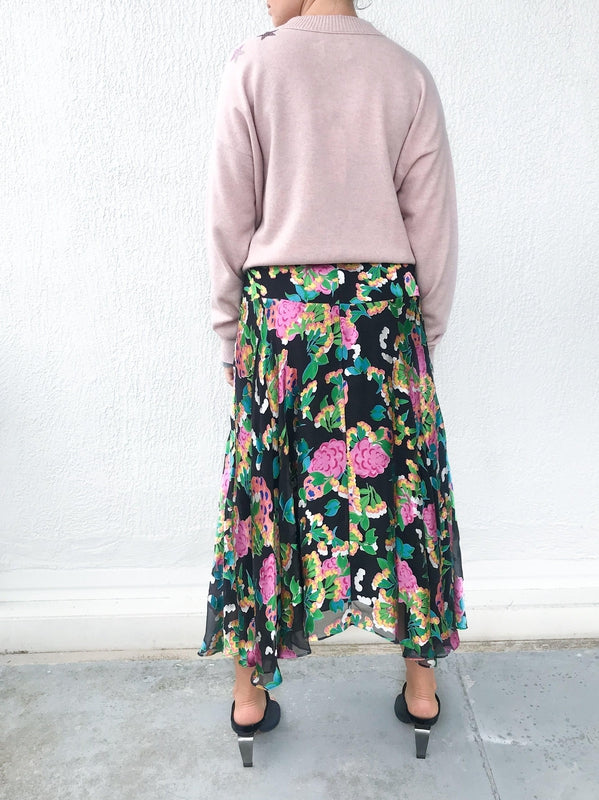 Saloni Ida Skirt in Hydrangea Floral print with soft sheer details, a high fitted waist and ankle length available at Debs Boutique. Styled on model wearing Zadig & Voltaire Gaby C Star Sweater and Clergerie Maevat Mules. Back view.