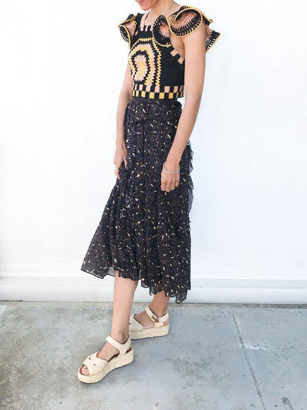 Ulla Johnson Fae Skirt in Jet, feminine silk-cotton-blend midi skirt with lurex stripes with a relaxed fit and fitted waist available at Debs Boutique. Styled on model wearing Ulla Johnson Caia Crochet Top and Clergerie Aude Sandals.