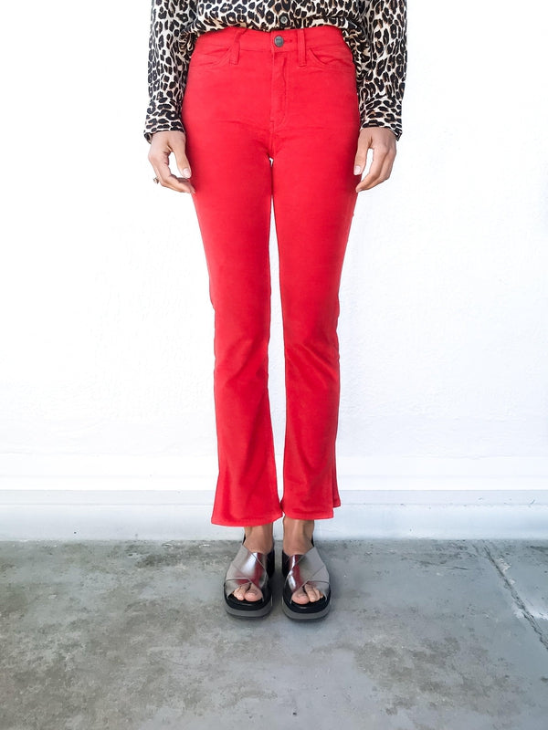 MiH Daily Velvet Highrise Slim Jean in Cherry Red with side split details and a slim fit available at Debs Boutique. Styled on model wearing Equipment Slim Signature Leopard Shirt. Close up front view.