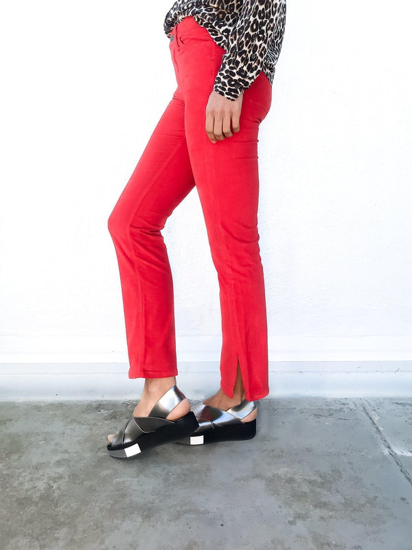 MiH Daily Velvet Highrise Slim Jean in Cherry Red with side split details and a slim fit available at Debs Boutique. Styled on model wearing Equipment Slim Signature Leopard Shirt. Side view.