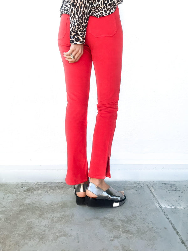 MiH Daily Velvet Highrise Slim Jean in Cherry Red with side split details and a slim fit available at Debs Boutique. Styled on model wearing Equipment Slim Signature Leopard Shirt. Back view.