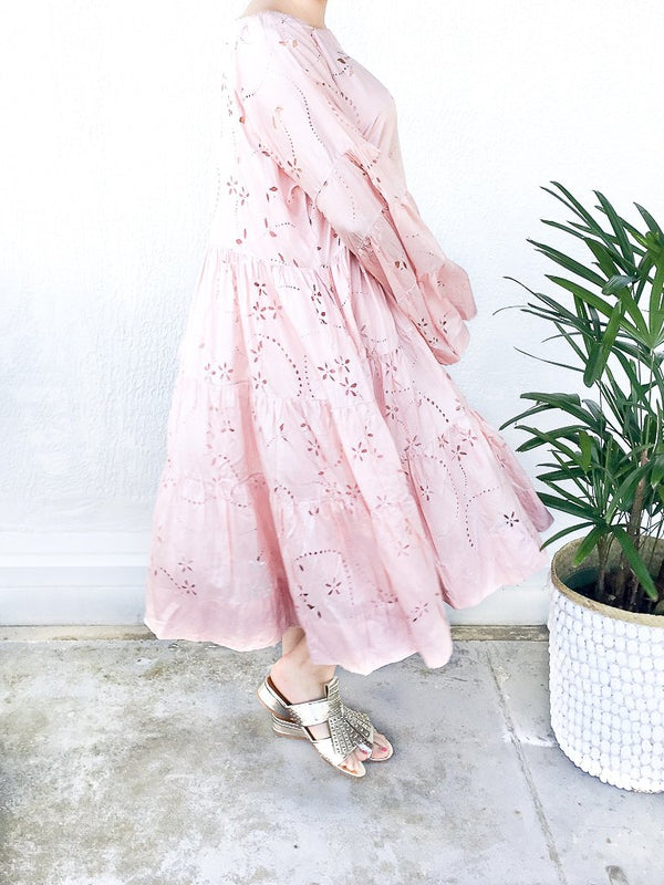 Pèro Lasercut silk dress in Pink, with trumpet sleeves, loose fit, dropped shoulders and boat neckline available at Debs Boutique. Styled on model with Clergerie Figlouc Sandals.