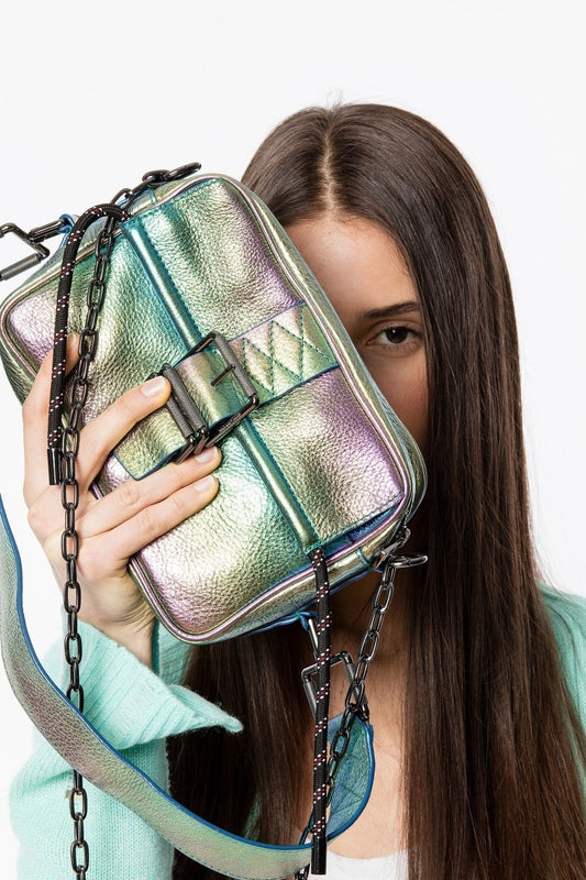 Zadig & Voltaire Johnny Rainbow bag in Multi, with a thin strap and buckle, made of soft but think multicoloured metallic leather available at Debs Boutique. Styled view with model holding bag.