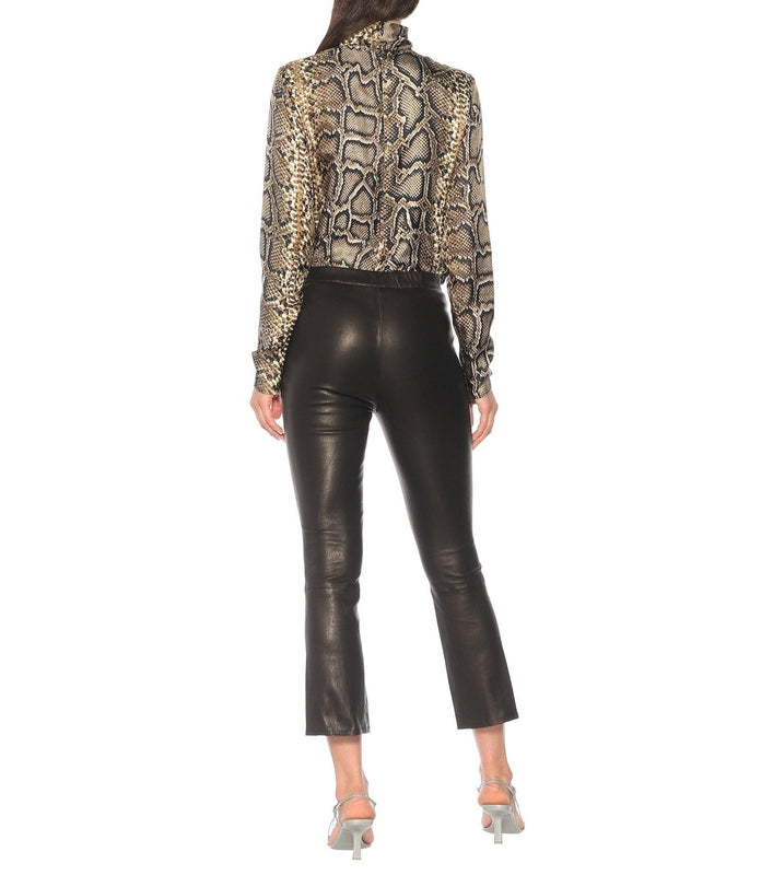 Style your j brand washable leather pants back with an animal print blouse like on the model here