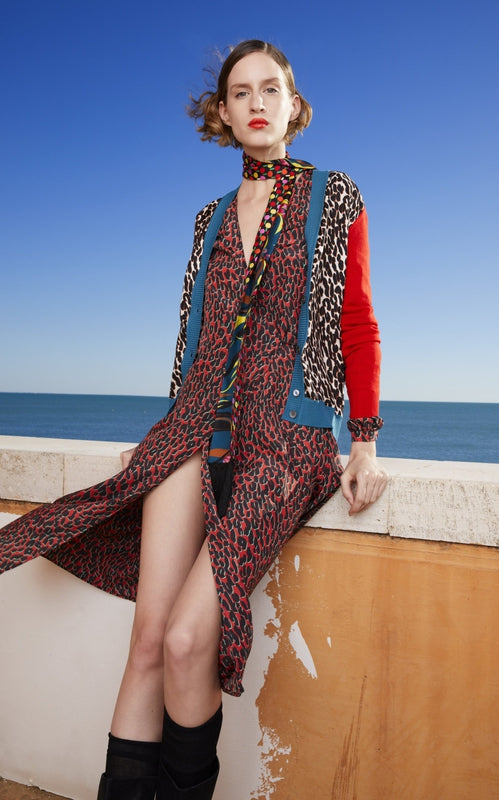 La Double J Gemini Cardigan in Leopard with red sleeves available at Debs Boutique. Styled on model at beach.