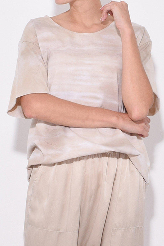 Raquel Allegra New Boxy Tie-Dye Tee in Sand, with a round neck, short sleeves and a relaxed fit available now at Debs Boutique. Styled on model, close up view.