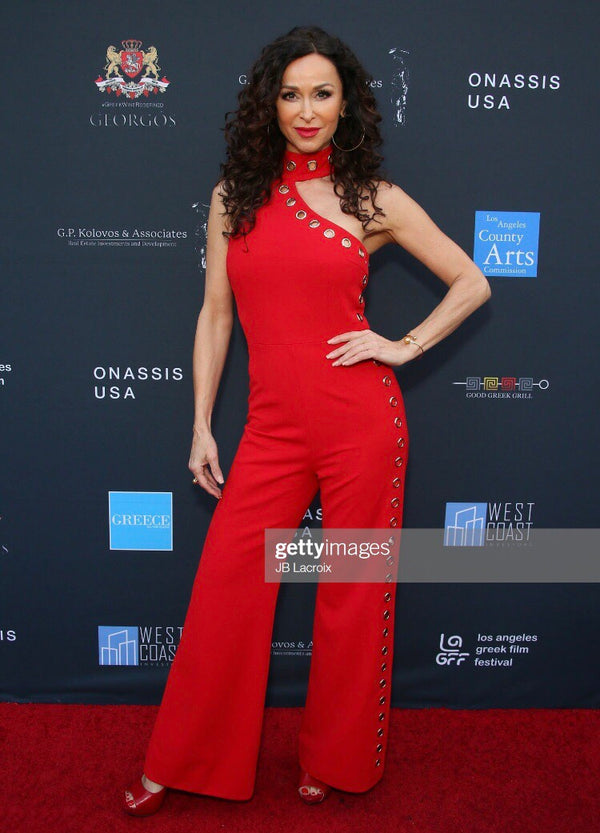 Lady in Red Sofia Milos wears a custom GEORGY piece.
