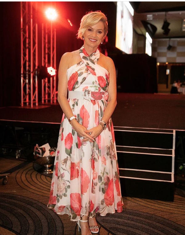 Sandra Sully in a Floral GEORGY Dress