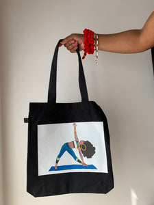 earth positive tote bag can be worn on hand or shoulder available in black and white