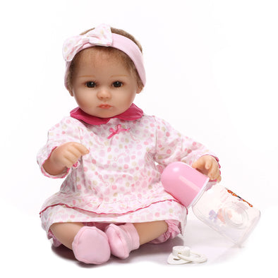 reborn baby doll with pink headband
