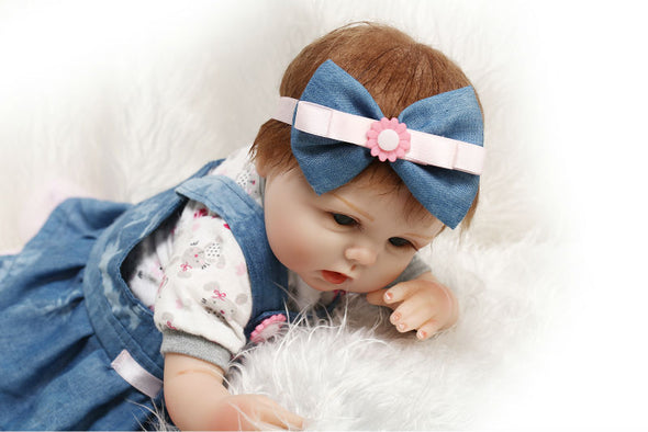 "22"" reborn baby doll with denim skirt"