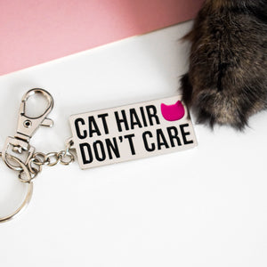 'Cat hair don't care' enamel keyring