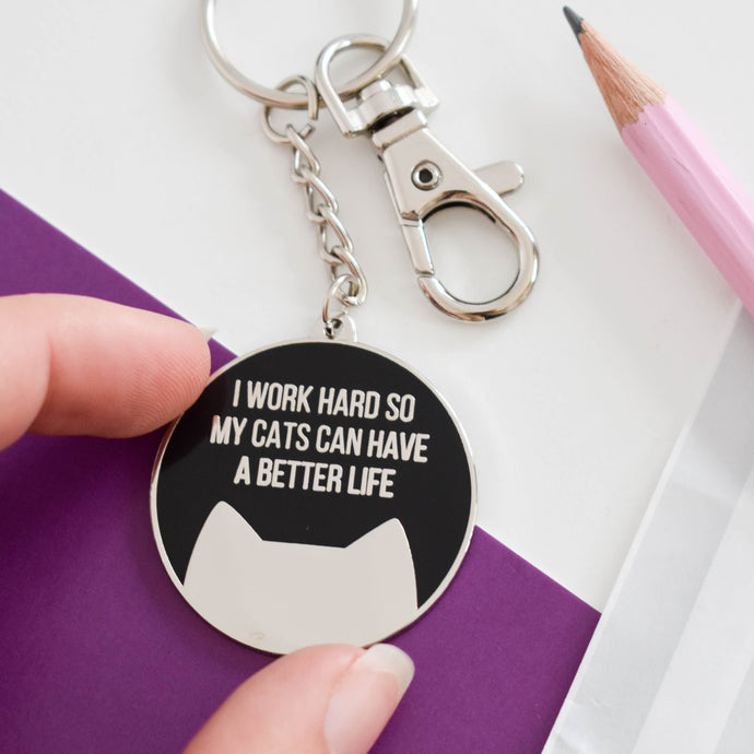 Work hard for my cat(s) enamel keyring