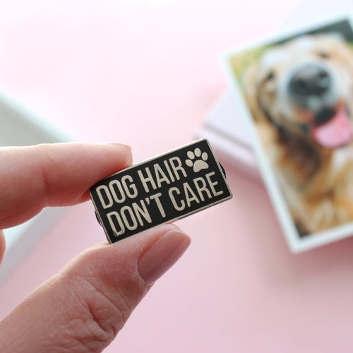 Dog hair don't care enamel pin