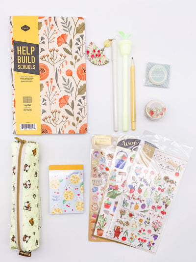 clockwise from top left: Floral journal, white pen with fan dangle, yellow pen with plant topper, yellow pencil, skinny plant washi, strawberry washi, love flower stickers, gardening stickers, hedgehog garden stickers, Cinnamarrol memo pad, rillakuma skinny pouch