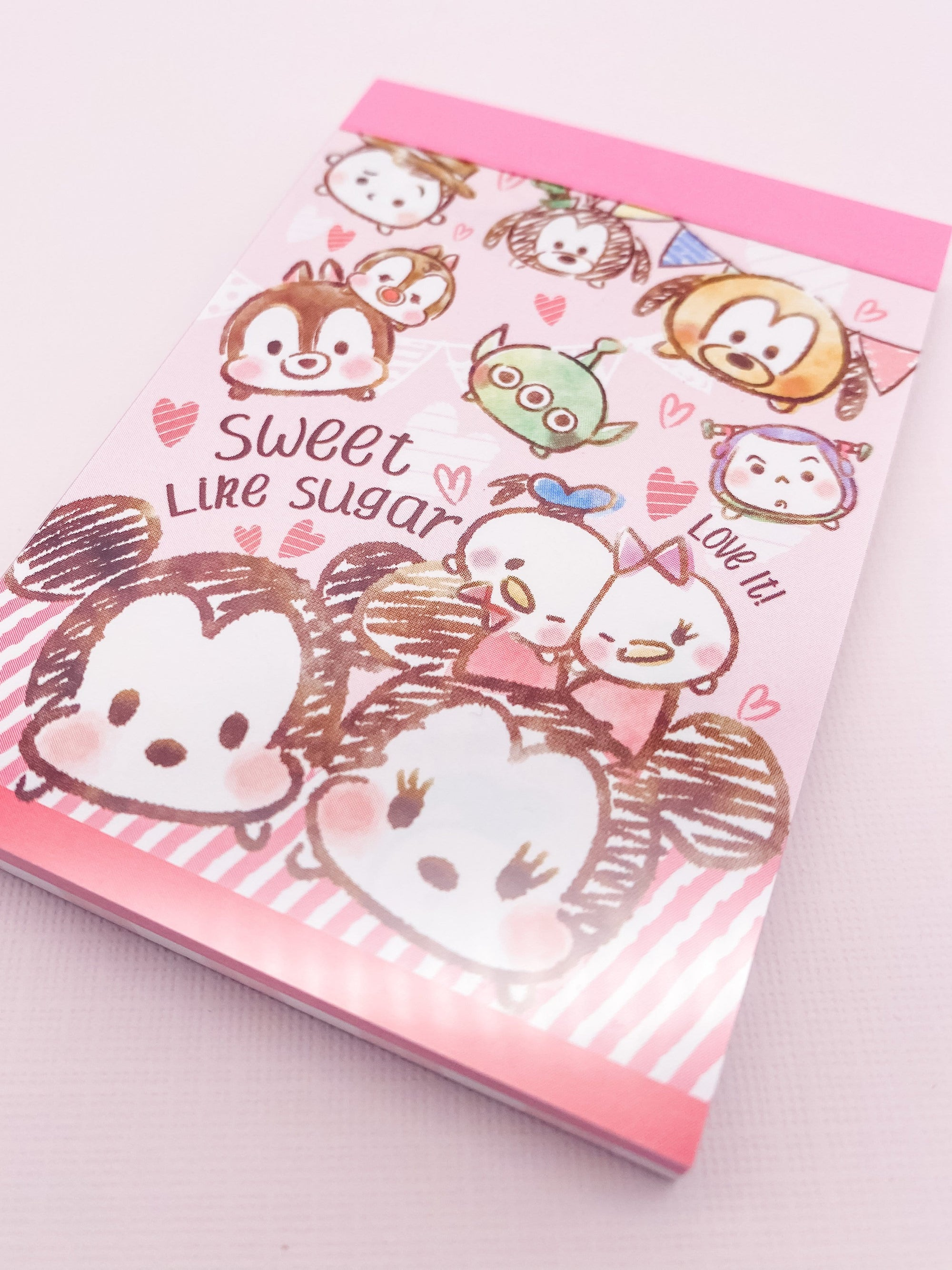 "Mini memo pad with Disney Tsum Tsum characters sketched on it. Says ""Sweet like sugar. Love it!"""