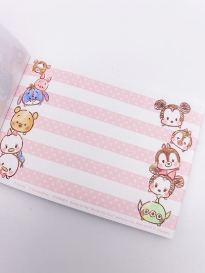 Page of mini memo pad. On the left, Tigger Piglet, Eeyore, Winnie the Pooh, Daisy, and Donald Tsum Tsums stack on top of each other. On the right, Mickey, Chip, Dale, Minnie, and Alien Tsum Tsums. Landscape orientation. Pink and white polka dot lines