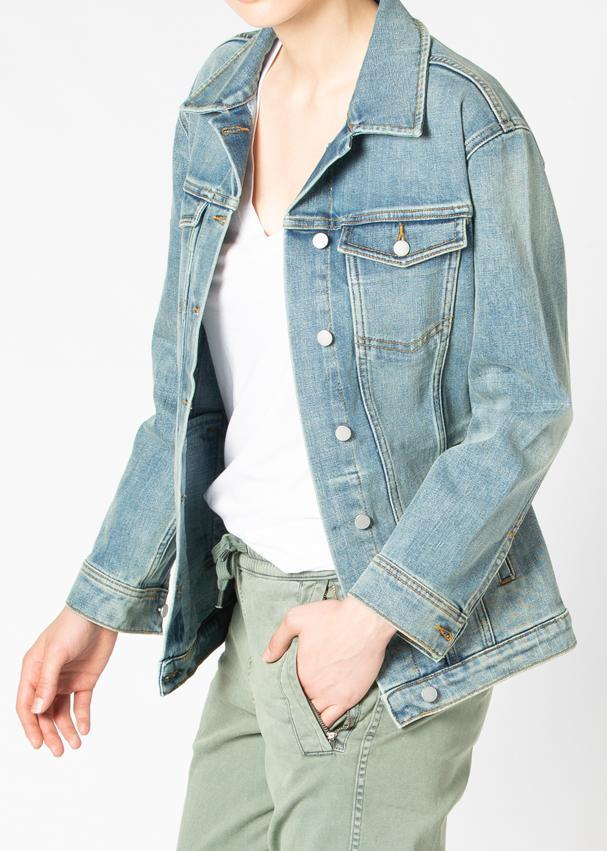 woman wearing stretch denim jacket side