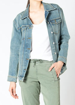 woman wearing stretch denim jacket front