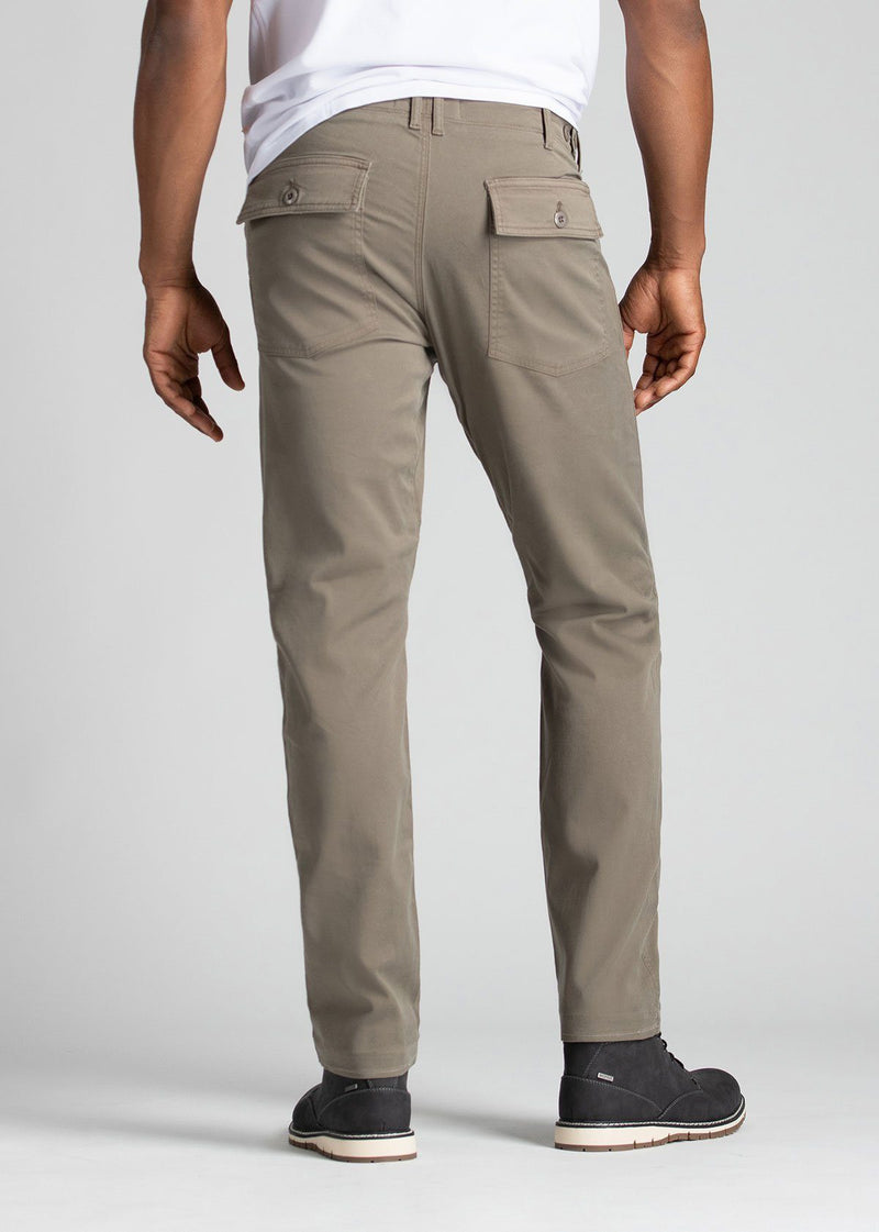 Man wearing light grey straight fit water resistant pants back