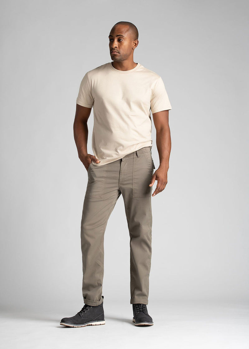Man wearing light grey straight fit water resistant pants full body