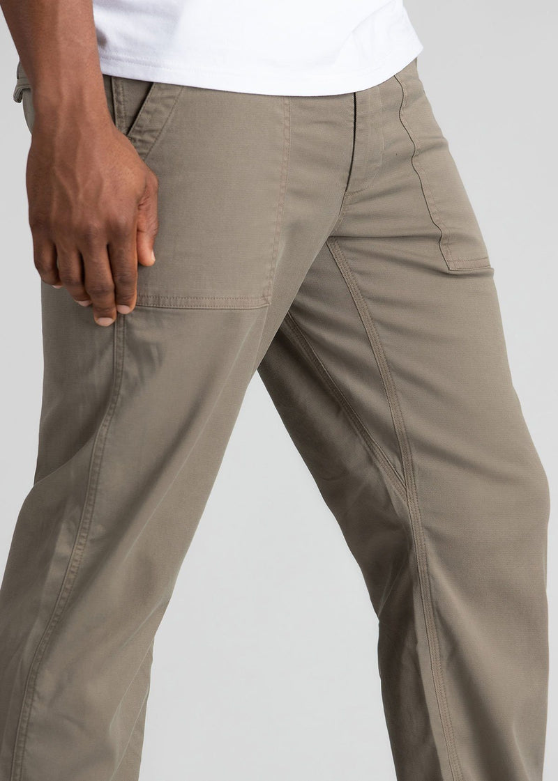 Man wearing light grey straight fit water resistant pants side detail