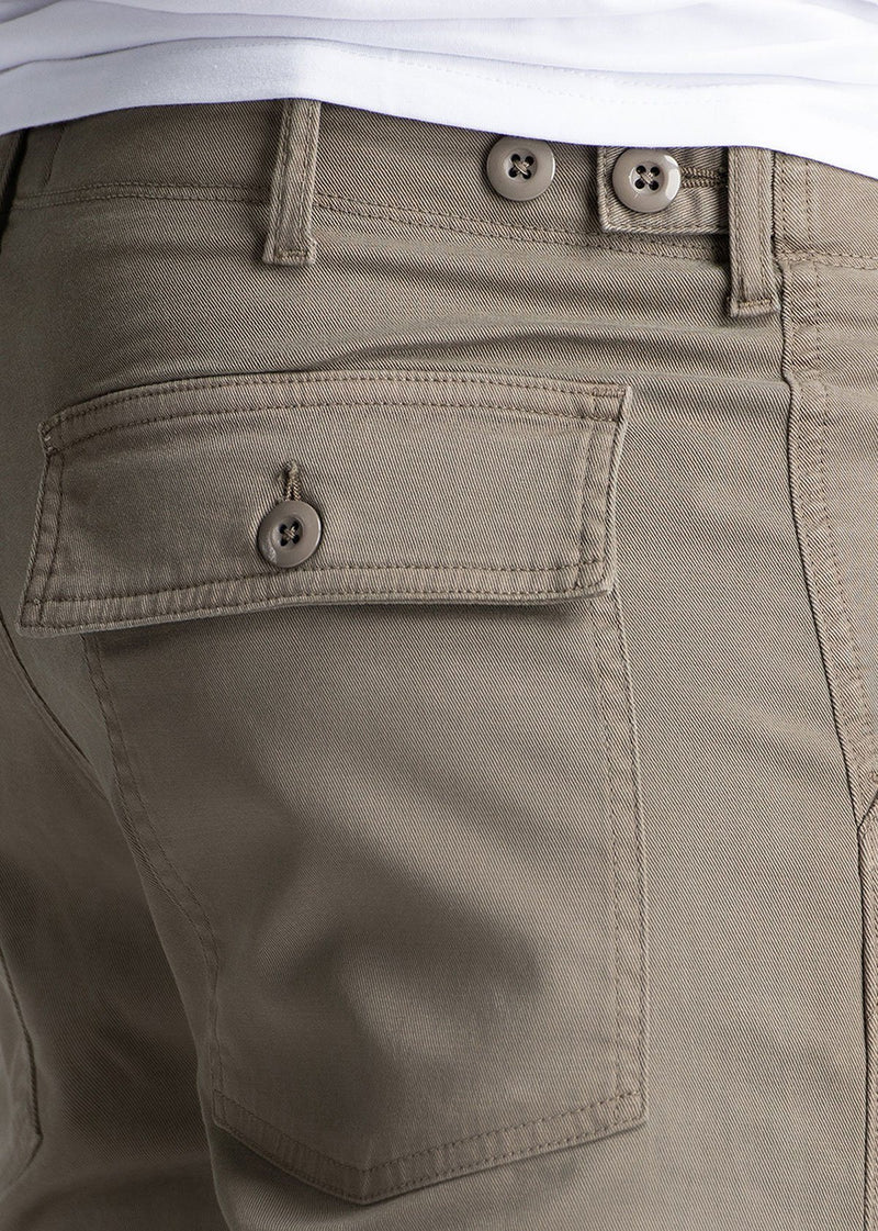 Man wearing light grey straight fit water resistant pants pocket detail