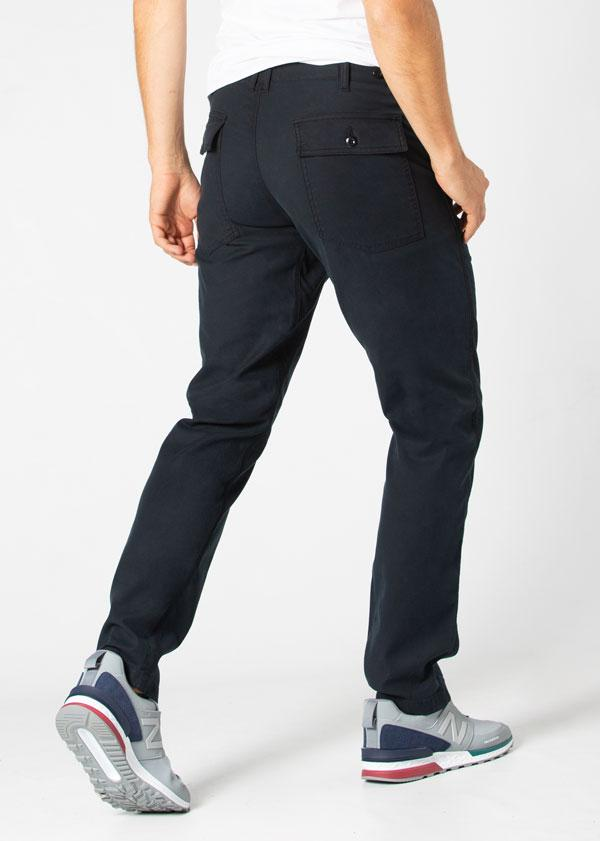 Man wearing dark blue Water resistant Pants back