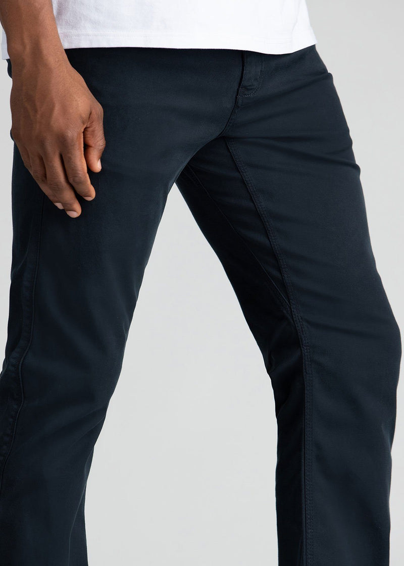 Man wearing navy Straight Fit Lightweight Pant side detail