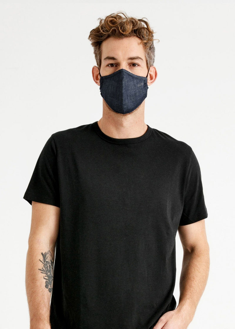 man wearing blue lightweight denim face mask