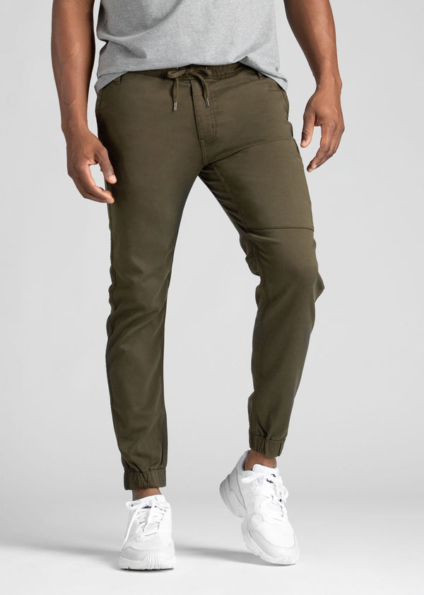 man wearing army green athletic joggers front