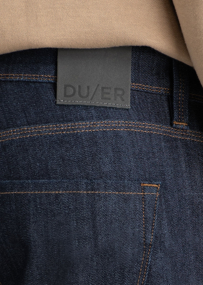 man wearing dark blue slim fit waterproof stretch jeans patch detail