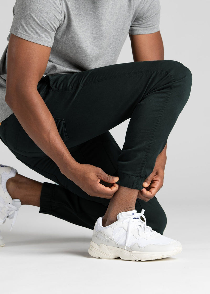man wearing dark teal athletic joggers cuff detail