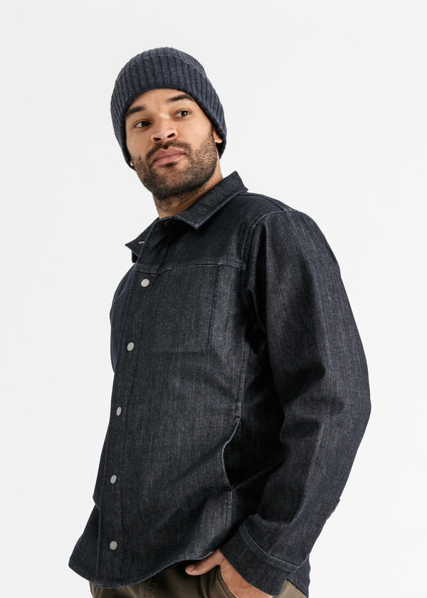 man wearing merino rib knit hat in indigo navy blue