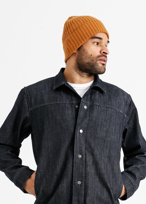 man wearing merino rib knit hat in burnt orange