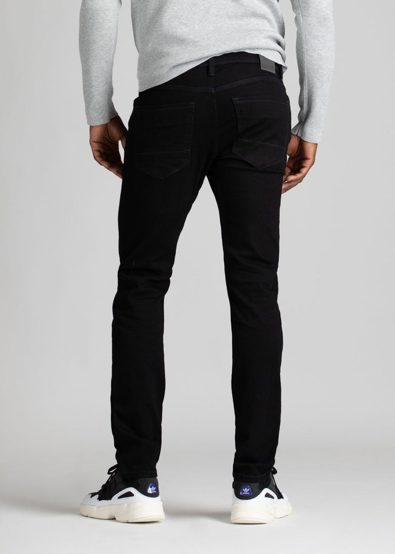 black water resistant slim jeans back view