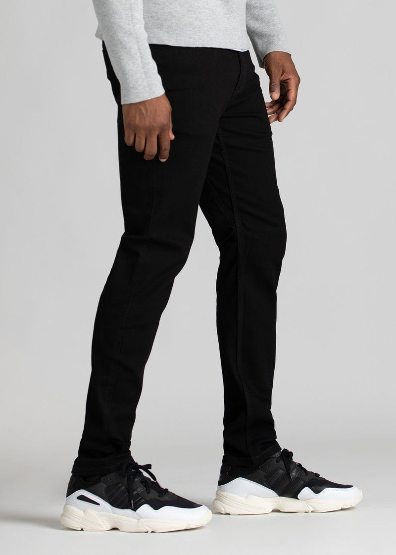 black water resistant slim jeans side view