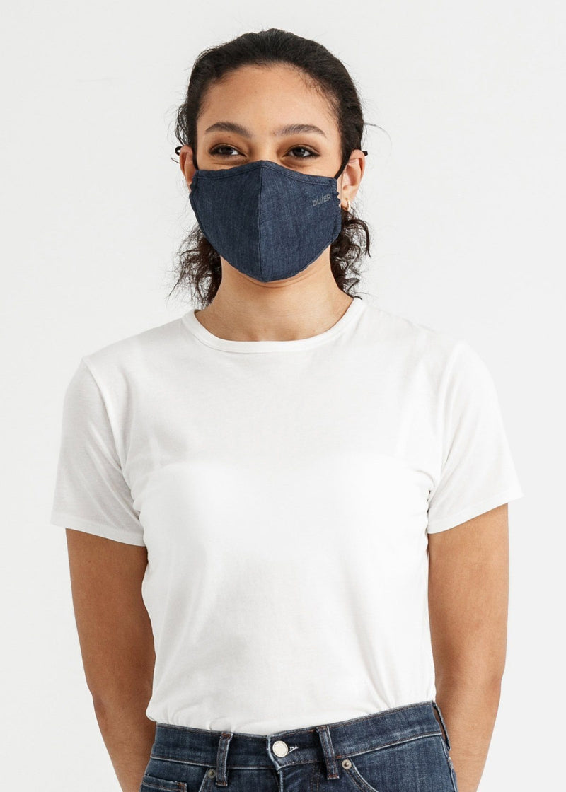 woman wearing blue lightweight denim face mask