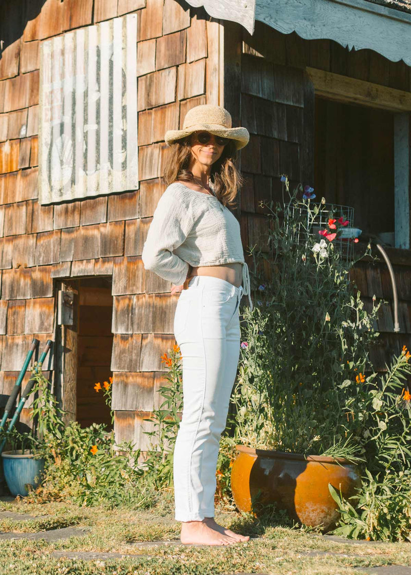woman-wearing-white-slim-straight-pants-in-garden